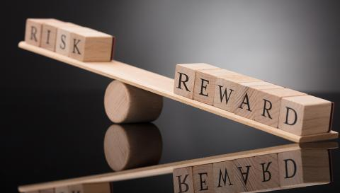 "word tiles that spell ""risk"" and ""reward"""