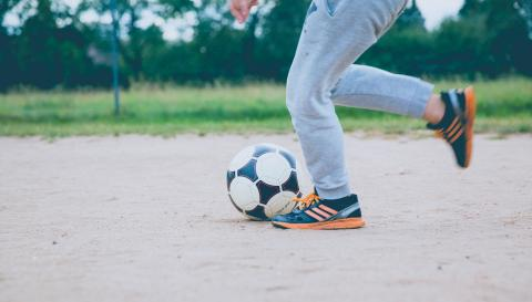 Child kicking soccer ball