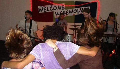 Teens enjoying a Welcome Werewolves concert