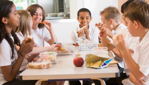 Students sitting around a lunch table