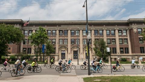 Group of bicyclists in front of building