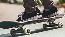 Person riding on skateboard on road