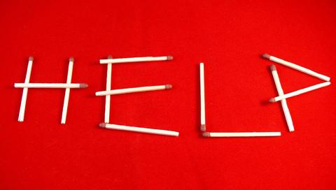 "the word ""help"" spelled in matches"