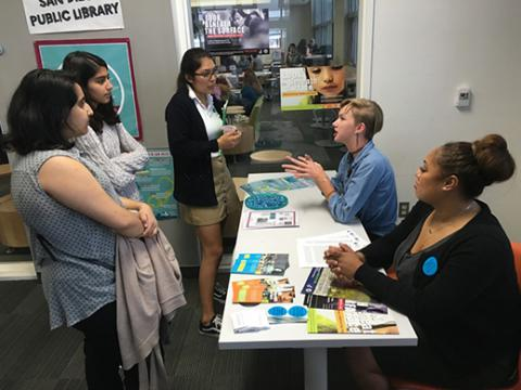 Two librarians talk to three young women about the dangers of sex trafficking.