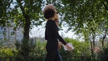 two women walking outside holding books