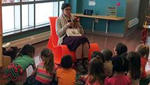 Jenn Carson reading to a group of kids