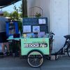 Photograph of the book bike at the Farmers Market