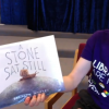 "A screenshot from a recorded story time of ""A Stone Sat Still"""