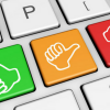 Image of a computer keyboard with green thumbs up, yellow middle thumb, red thumbs down.
