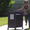 Librarian running with book cart outdoors