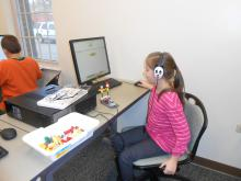 Girl at computer using LEGO software