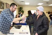 A community member tests her grip at the library's Family Health and Safety Fair.