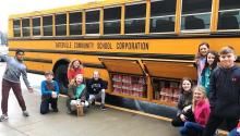 Photograph of Junior Ambassadors loading a bus of donated items to be sent to children in Haiti.