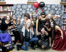 Zombie prom attendees in zombie attire