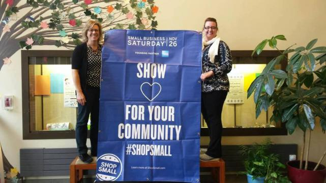 Library staff with Small Business Saturday sign