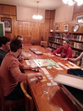 Students playing a board game in the library