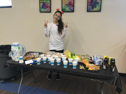 Photo of participant smiling at snack table.