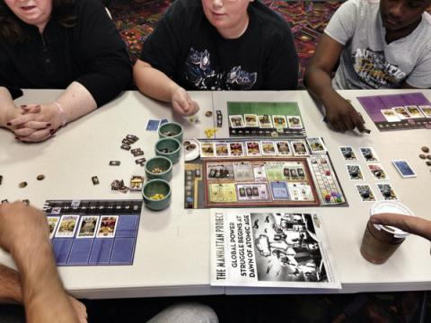 Participants playing a board game