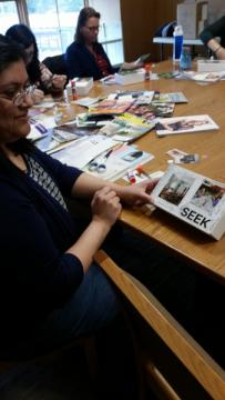 A woman holds her meditation box.
