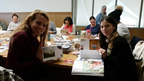 Two participants smile for the camera while holding their meditation boxes.