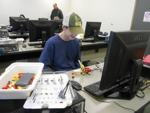 Boy using LEGO software