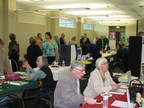 Patrons visiting booths at the Senior Expo