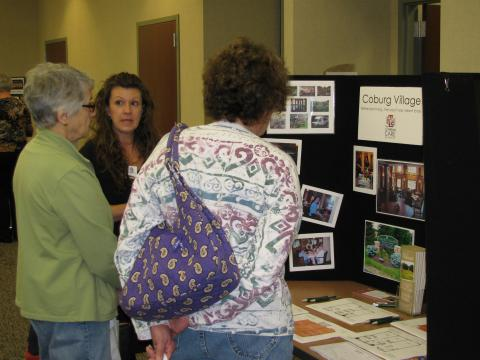 Patrons speaking with vendor at Senior Expo