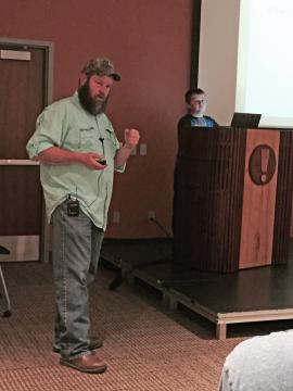 Speaker and son presenting about chicken coops