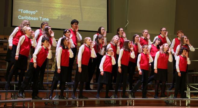 Children onstage singing