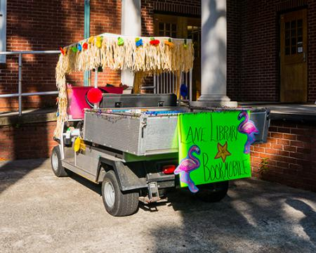 Back of decorated golf cart for bookmobile