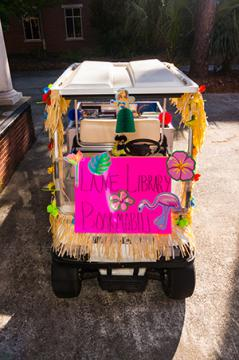 Front of decorated golf cart for bookmobile