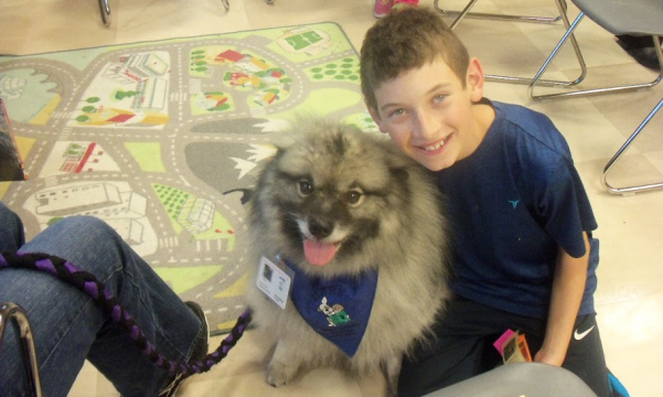 Boy with fluffy dog