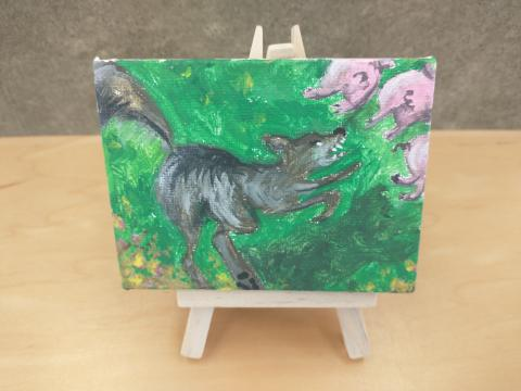 Photo of art canvas with painting of wolf and three pigs