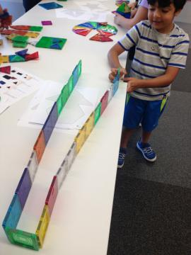 Child playing with Magna-Tiles