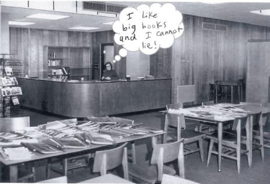 Woman behind a desk in the library