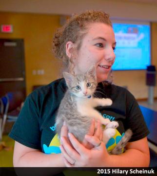 Project Purr volunteer handling kitten