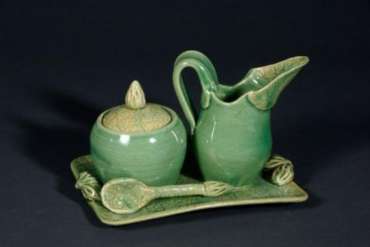 A ceramic cream and sugar set
