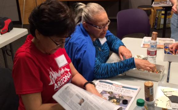 Two participants use reclaimed objects to create jewelry during a Creative Aging session.