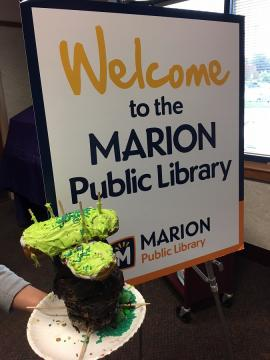 Sign for Marion Public Library next to donut diorama
