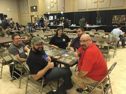 Group around a table playing Dice Tower