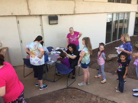 A line awaiting face painting
