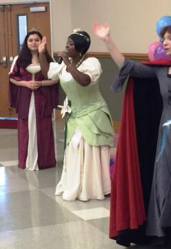 A woman dressed as Princess Tiana sings to the crowd.