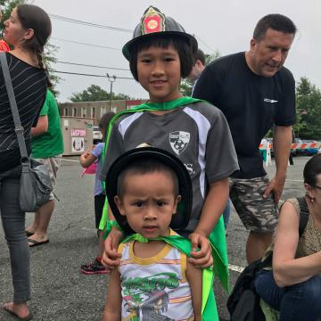 Boys in hats from the Fire Department