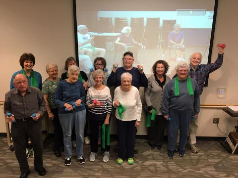 group photo of senior citizens holding weights