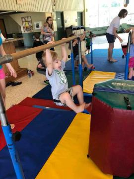Child playing on gymnastics equipment