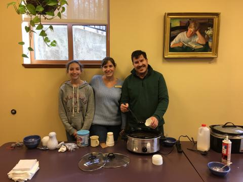 Volunteers serve homemade hot chocolate.
