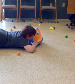 Boy playing the Hungry Hungry Hippos game
