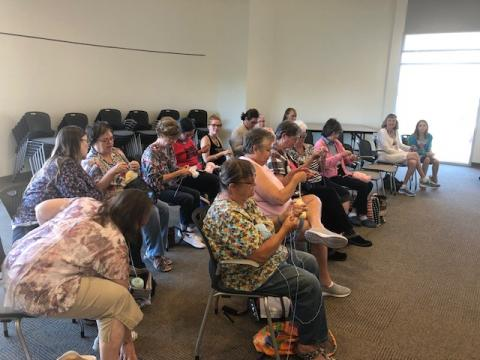 Rows of knitters at work