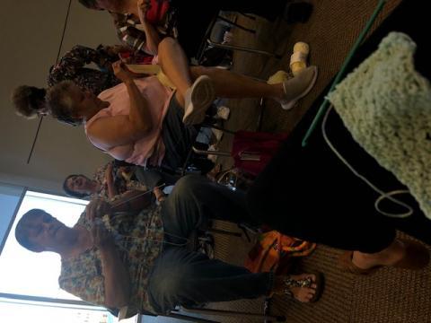 Women knitting baby blankets