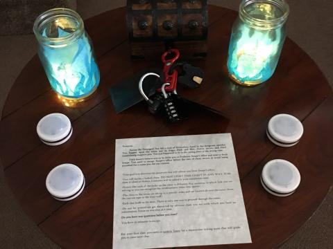 Table with instructions, locks, and candles